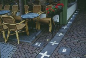Border line of the Netherlands and Belgium. 'B' indicates Belgium and 'NL' indicates the Netherlands. And the border line goes through a coffee shop!